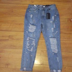 Distressed pearl boyfriend jeans